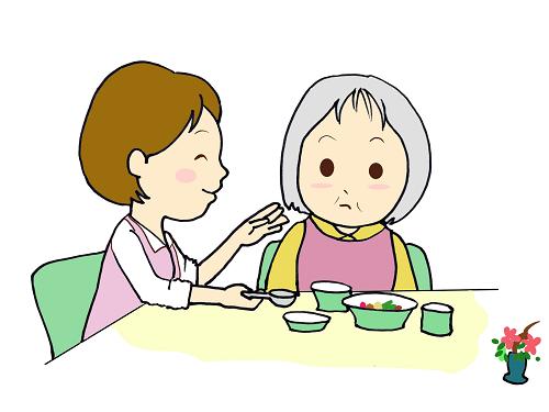 食事介助される高齢者の画像