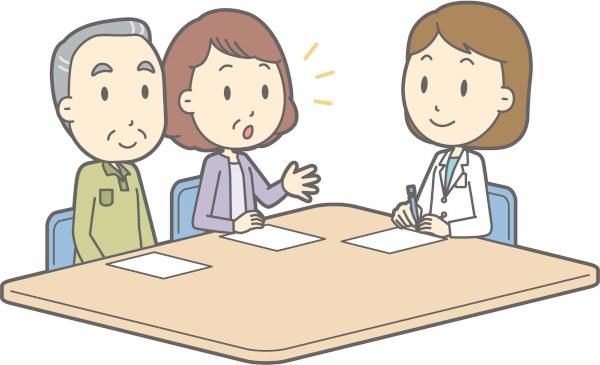 医者と相談している家族の画像